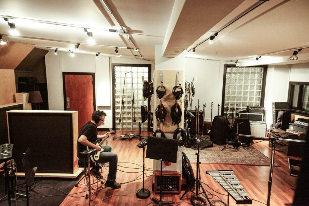 Best Audio Production Tools: Guitarist in Studio